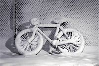 Snow Covered Bike Leaning on Snow Covered Fence in Winter    Stock Photo - Premium Rights-Managednull, Code: 700-00080705