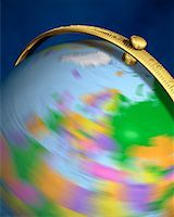 Blurred View of Globe Spinning On Stand Europe    Stock Photo - Premium Rights-Managednull, Code: 700-00080718