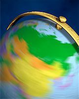 Blurred View of Globe Spinning On Stand Asia    Stock Photo - Premium Rights-Managednull, Code: 700-00080720