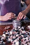 Close-Up of Hands Packing Cans of Fish at Fish Processing Plant Maine, USA    Stock Photo - Premium Rights-Managed, Artist: David Mendelsohn, Code: 700-00081183