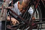 Mature Man Fixing Bike in Shop Singapore    Stock Photo - Premium Rights-Managed, Artist: David Mendelsohn, Code: 700-00082160