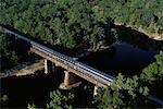 Aerial View of Passenger Train Crossing Chipola River Florida, USA