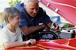 Grandfather and Grandson Working On Engine in Hot-Rod    Stock Photo - Premium Rights-Managed, Artist: Peter Griffith, Code: 700-00086240