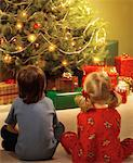 Boy and Girl by Christmas Tree