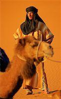desert people dress photos - Berber and Camel Near Merzouga, Sahara Desert Morocco    Stock Photo - Premium Rights-Managednull, Code: 700-00087159