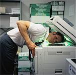 Businessman Photocopying Face    Stock Photo - Premium Rights-Managed, Artist: Tom Feiler, Code: 700-00088910