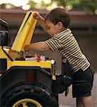Child Fixing Car    Stock Photo - Premium Rights-Managed, Artist: Dan Lim, Code: 700-00090236
