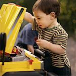 Child Fixing Car    Stock Photo - Premium Rights-Managed, Artist: Dan Lim, Code: 700-00090237