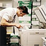 Businessman Using Photocopier    Stock Photo - Premium Rights-Managed, Artist: Tom Feiler, Code: 700-00093322