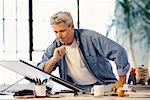 Man Sitting at Drafting Table    Stock Photo - Premium Rights-Managed, Artist: MTPA Stock, Code: 700-00096647
