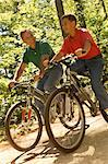 Father and Son Riding Bicycles    Stock Photo - Premium Rights-Managed, Artist: Peter Barrett, Code: 700-00097625
