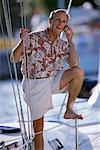 Man on Sailboat Talking on Cell Phone    Stock Photo - Premium Rights-Managed, Artist: Raoul Minsart, Code: 700-00150629