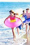 Children Running on Beach with Inner Tubes    Stock Photo - Premium Rights-Managed, Artist: Kevin Dodge, Code: 700-00150966
