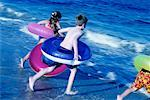 Children Running on Beach with Inner Tubes    Stock Photo - Premium Rights-Managed, Artist: Kevin Dodge, Code: 700-00150970