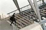 Businessman Walking Up Steps    Stock Photo - Premium Rights-Managed, Artist: Min Roman, Code: 700-00151215