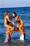 Teenagers Playing On The Beach    Stock Photo - Premium Rights-Managed, Artist: Kevin Dodge, Code: 700-00151762