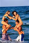 Teenagers Playing On The Beach    Stock Photo - Premium Rights-Managed, Artist: Kevin Dodge, Code: 700-00151763