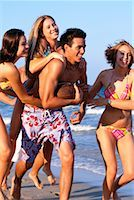 Teenagers Playing On The Beach    Stock Photo - Premium Rights-Managednull, Code: 700-00151769