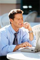 Businessman Using Laptop at Outdoor Cafe    Stock Photo - Premium Rights-Managednull, Code: 700-00152302