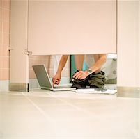 Woman Using Laptop in Bathroom Stall    Stock Photo - Premium Rights-Managednull, Code: 700-00153649