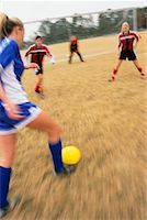 Teenage Girls Playing Soccer    Stock Photo - Premium Rights-Managednull, Code: 700-00158052