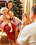 Father Taking Picture of Family At Christmas    Stock Photo - Premium Rights-Managed, Artist: Kevin Radford, Code: 700-00158083