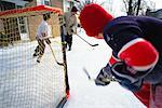 Kids Playing Ice Hockey Outdoors    Stock Photo - Premium Rights-Managed, Artist: Curtis R. Lantinga, Code: 700-00158179
