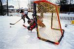 Kids Playing Ice Hockey Outdoors    Stock Photo - Premium Rights-Managed, Artist: Curtis R. Lantinga, Code: 700-00158183