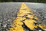 Close-Up of Center Line of Paved Road    Stock Photo - Premium Rights-Managed, Artist: Boden/Ledingham, Code: 700-00158243