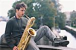 Young Man Playing Saxophone in City    Stock Photo - Premium Rights-Managed, Artist: George Shelley, Code: 700-00158502