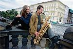 Young Woman listening to Young Man playing Saxophone    Stock Photo - Premium Rights-Managed, Artist: George Shelley, Code: 700-00158504