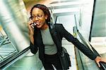 Woman on Escalator Using Cellular Phone    Stock Photo - Premium Rights-Managed, Artist: Brian Pieters, Code: 700-00158741