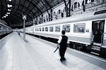 Conductor Walking on Train Platform    Stock Photo - Premium Rights-Managed, Artist: Damir Frkovic, Code: 700-00158986