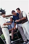 Men Looking at Golf Score Card    Stock Photo - Premium Rights-Managed, Artist: Kevin Dodge, Code: 700-00163046