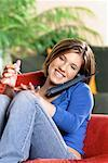 Girl Applying Nail Polish and Talking on Phone    Stock Photo - Premium Rights-Managed, Artist: Brian Pieters, Code: 700-00164419