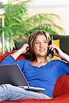 Girl Using Laptop Computer and Phone    Stock Photo - Premium Rights-Managed, Artist: Brian Pieters, Code: 700-00164421