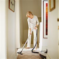 Woman Vacuuming    Stock Photo - Premium Rights-Managednull, Code: 700-00167235