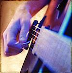 Close-Up of Hand Strumming Guitar    Stock Photo - Premium Rights-Managed, Artist: Tom Collicott, Code: 700-00168229
