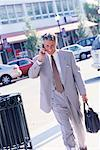 Businessman Walking and Using Cellular Phone    Stock Photo - Premium Rights-Managed, Artist: Kevin Dodge, Code: 700-00168707
