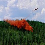 Firefighting Plane Dropping Fire Retardant on Forest    Stock Photo - Premium Rights-Managed, Artist: Noel Hendrickson, Code: 700-00169003