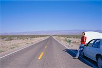 peter griffith - Person on Cell Phone by Stranded Car, Nevada, USA    Stock Photo - Premium Royalty-Freenull, Code: 600-00171304
