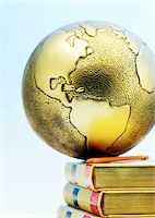 Close-Up of Globe on Books    Stock Photo - Premium Royalty-Freenull, Code: 600-00177430