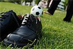 Businessman's Shoes and Businessman Playing Soccer