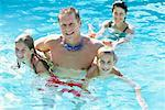 Family in Swimming Pool    Stock Photo - Premium Rights-Managed, Artist: George Shelley, Code: 700-00178453