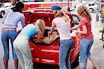 Teenage Girls Loading Car