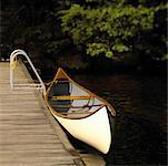 Canoe Tied to Dock    Stock Photo - Premium Rights-Managed, Artist: Michael Mahovlich, Code: 700-00184069