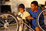 Father and Son Fixing Bicycle    Stock Photo - Premium Rights-Managed, Artist: David Schmidt, Code: 700-00185898