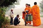 Monks Collecting Alms from Villagers Thailand    Stock Photo - Premium Rights-Managed, Artist: R. Ian Lloyd, Code: 700-00187389
