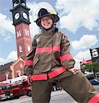 Child Dressed Up Like a Firefighter    Stock Photo - Premium Rights-Managed, Artist: Dan Lim, Code: 700-00190280
