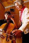Student Playing Cello for Teacher    Stock Photo - Premium Rights-Managed, Artist: Mitch Tobias, Code: 700-00190877